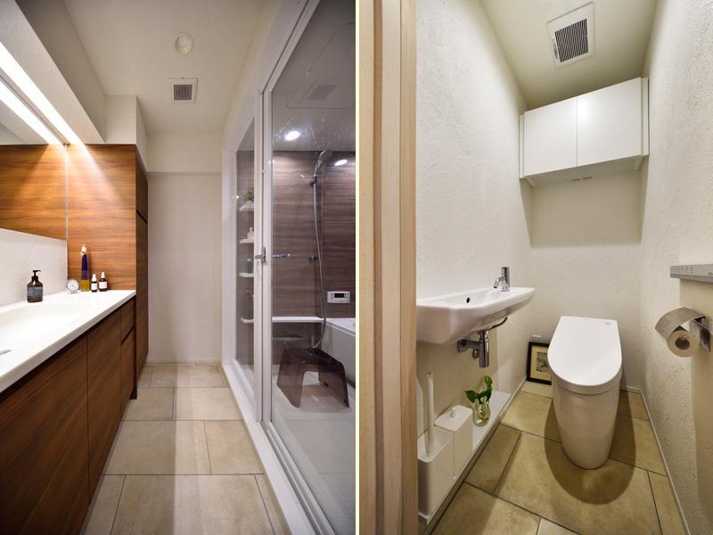 上品で洗練された装いの洗面室・トイレです。限られた空間をより広く感じるよう浴室は全面ガラス、トイレはタンクレスを採用しました。面を上手に使って収納家具をご用意。
